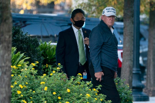 President Donald Trump returns to the White House after playing a round of golf on Saturday.