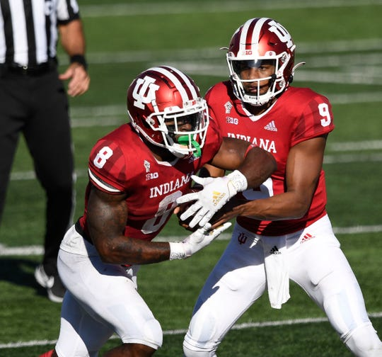 Indiana quarterback Michael Penix Jr., right and running back Stevie Scott III led the Hooisers to victory over Michigan on Saturday.