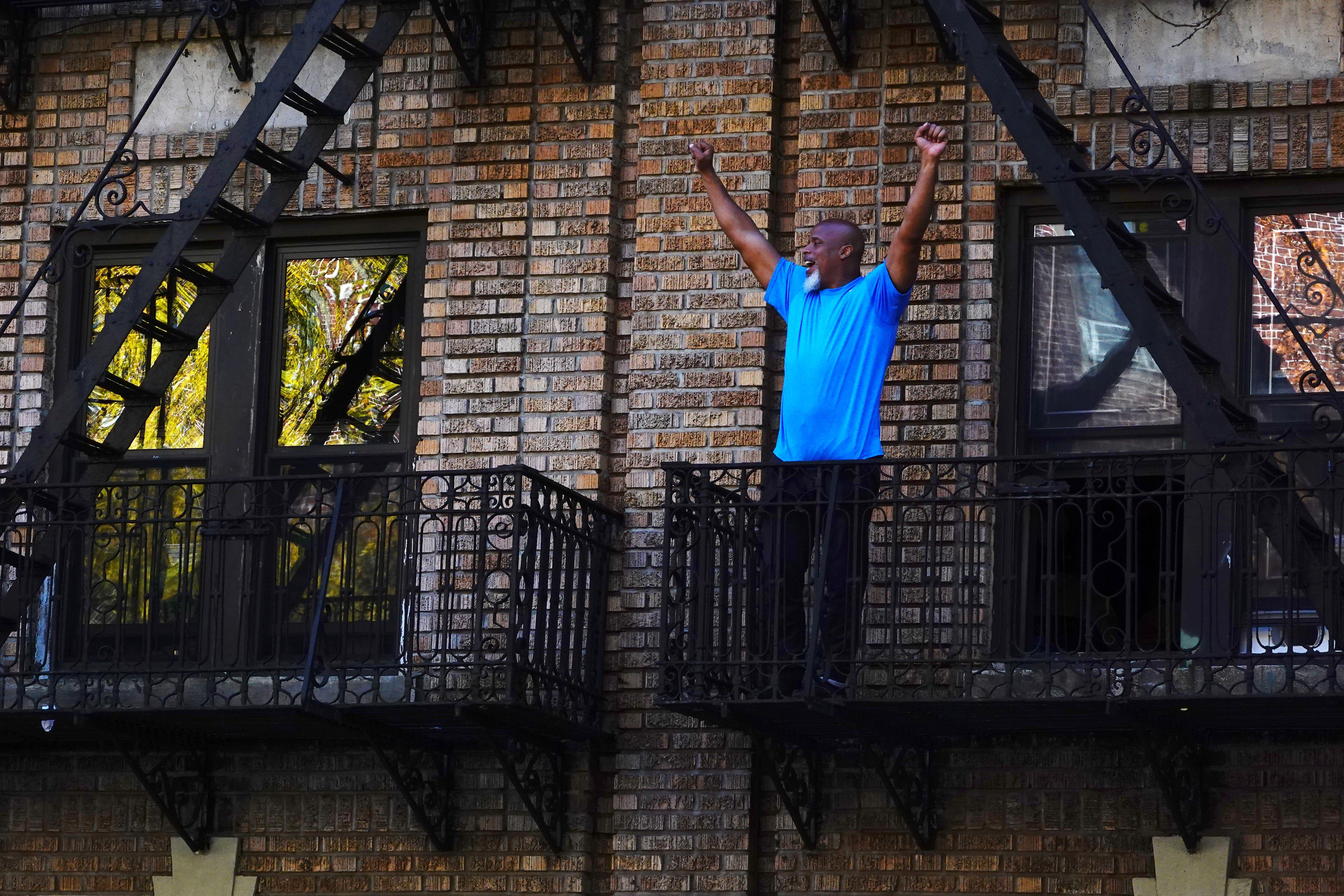 A man celebrates in the Flatbush neighborhood of Brooklyn after Joe Biden was declared winner.
