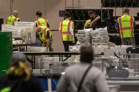 Election workers count ballots at the Philadelphia Convention Center on November 06, 2020 in Philadelphia, Pennsylvania. Joe Biden took the lead in the vote count in Pennsylvania on Friday morning from President Trump, as mail-in ballots continue to be counted in the battleground state.