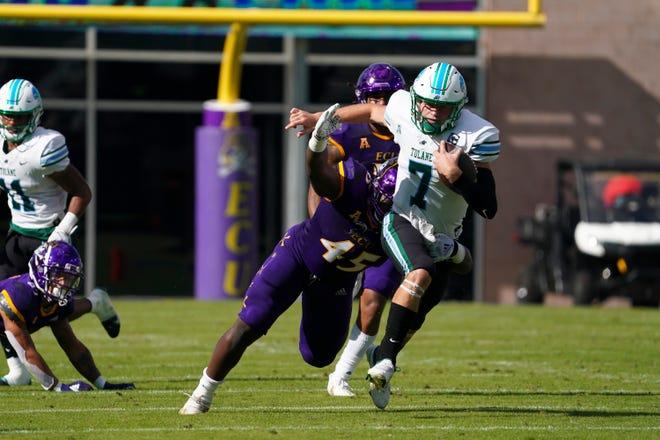 Tulane quarterback Michael Pratt runs past East Carolina defensive lineman Rick D'Abreu earlier this season.