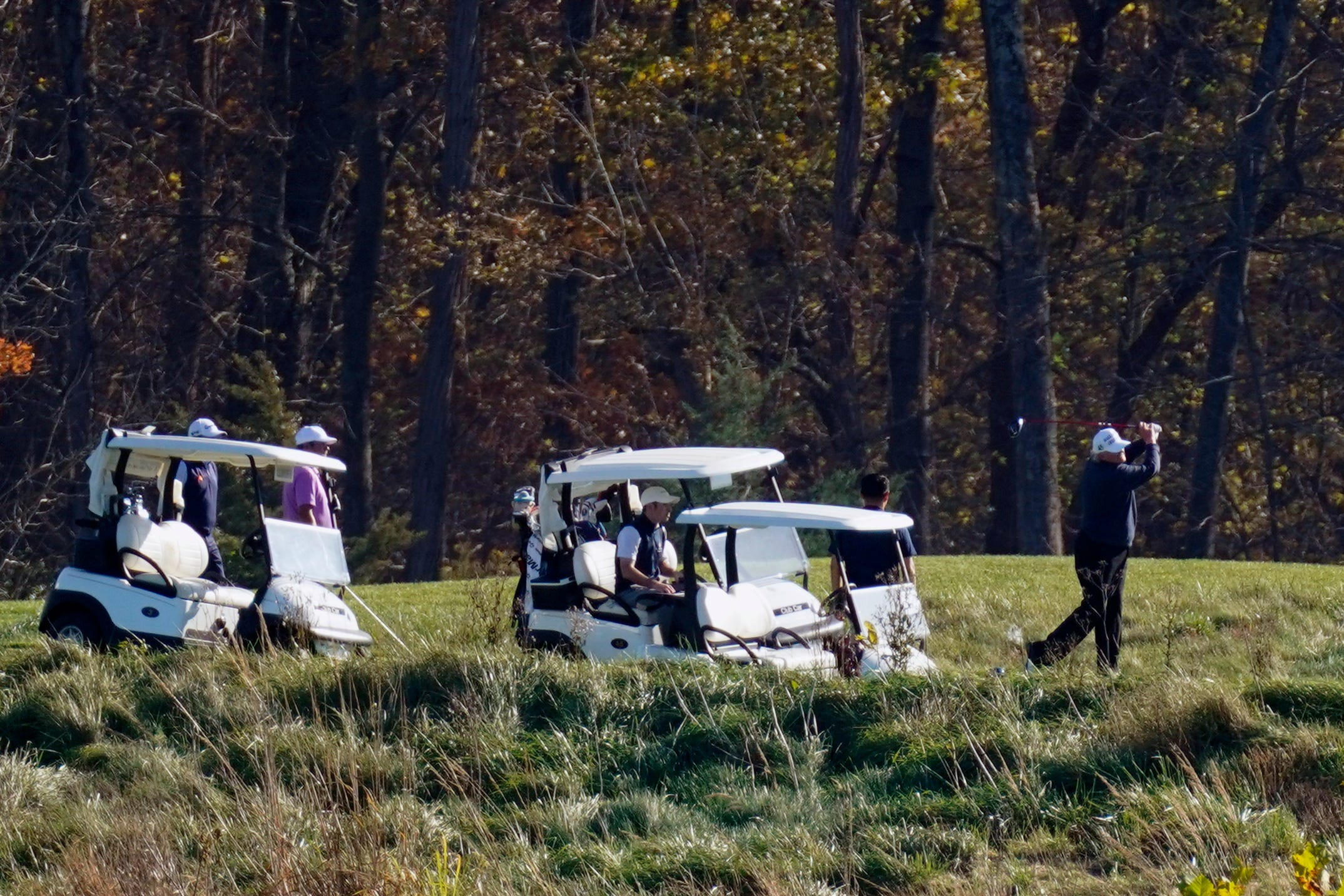 President Donald Trump participates in a round of golf at the Trump National Golf Course.