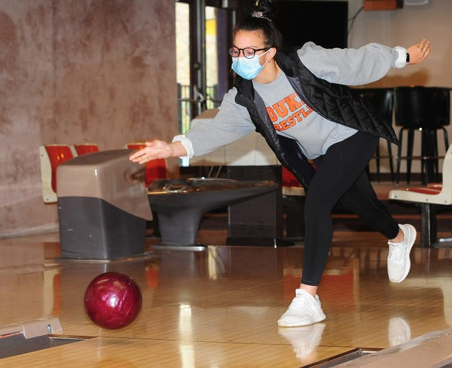 Calli Swisher participates Nov. 1 in a bowling fundraiser at Alliance Elks Lodge 467. The event was part of the Washington Ruritans' Rising Senior project, which raises funds for community activities.
