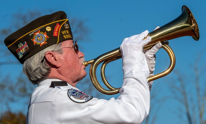 U.S. Navy Special Operations Retired, Robert Crossett, of Plumstead Township, plays taps during the 14th annual Lower Makefield Township Veterans Commemorative Ceremony, held at Veterans Square Park, on Saturday, Nov. 7, 2020.