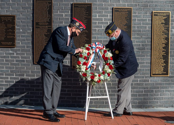 Placing the wreath are VFW Post 6393 Commander Russ Davidson, (left), and American Legion Post 317 Commander Ted Smith, during the 14th annual Lower Makefield Township Veterans Commemorative Ceremony, held at Veterans Square Park, on Saturday, Nov. 7, 2020.