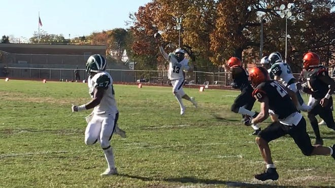 West Deptford quarterback Aaron Graeber (13) throws a pass for J'Covi Williams (27) during Saturday's West Jersey Football League meeting with Woodrow Wilson. Williams caught the pass for a 5-yard touchdown.