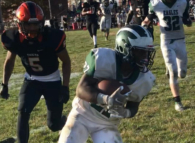 West Deptford running back J'Covi Williams (27) heads up the sideline with Woodrow Wilson's Elijah Lopez in pursuit on the way to a 33-yard touchdown. The Eagles defeated Wilson, 42-34, in their West Jersey Football League game.