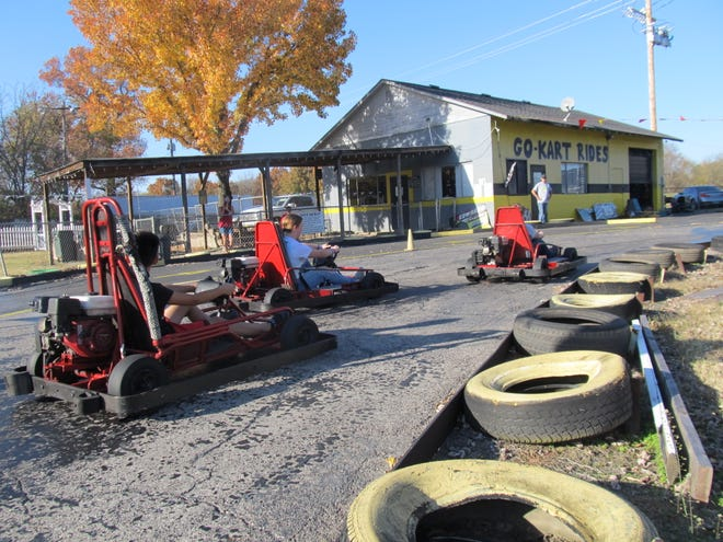Patrons race go karts at Crossroads Go Kart Track on Saturday, the day before owner Richard Wimer closed the track.