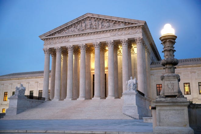 In this May 23, 2019 file photo, the U.S. Supreme Court building at dusk, on Capitol Hill in Washington.