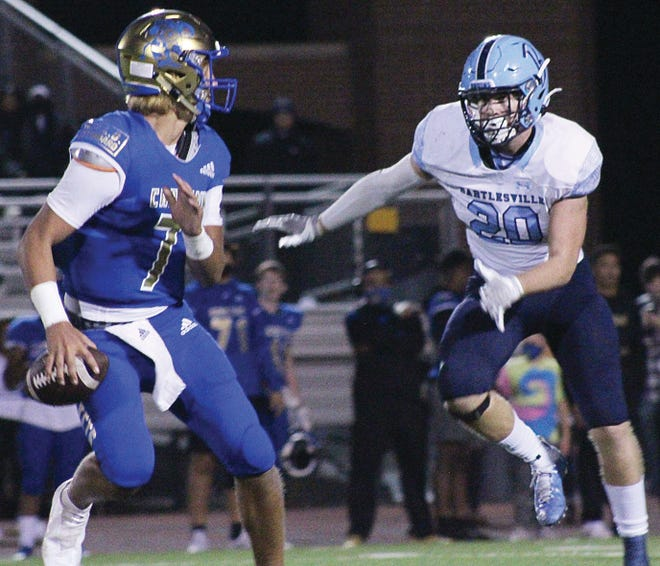 Bartlesville High senior linebacker Rocky Shuman, right, closes in on Choctaw quarterback Steele Wasel during Friday's battle.