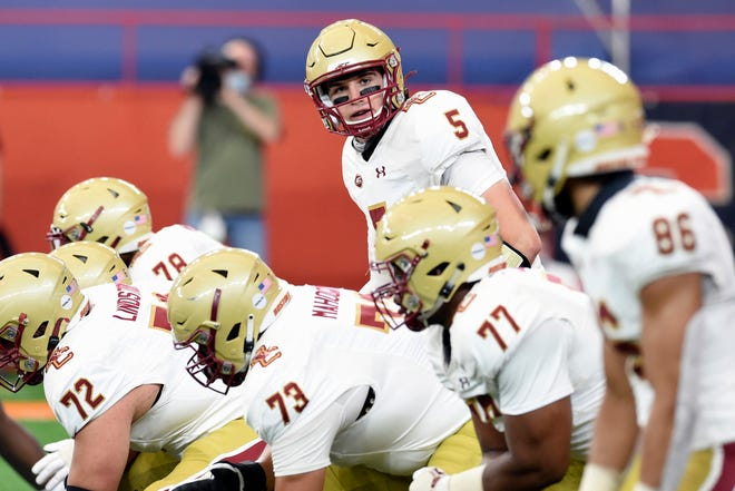 Boston College quarterback Phil Jurkovec looks down the line of scrimmage during the first half of the Eagles' victory over Syracuse on Saturday. [Dennis Nett/The Post-Standard via AP]