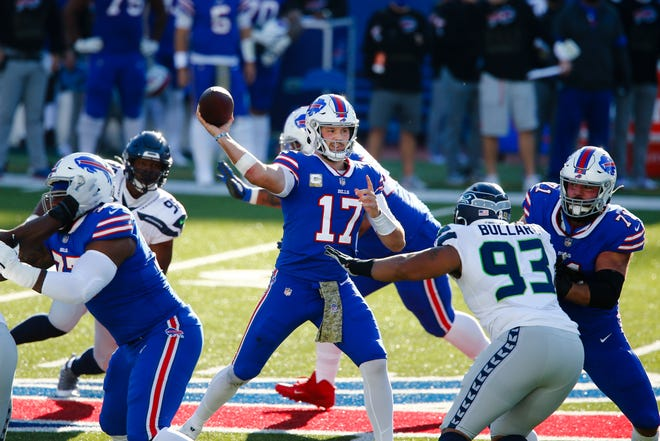 Buffalo quarterback Josh Allen looks to throw against the Seahawks on Sunday. [John Munson/Associated Press]