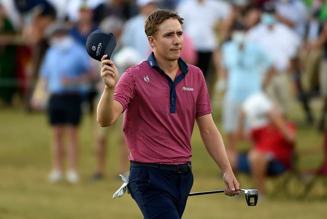 Carlos Ortiz acknowledges the gallery as he walks up to the 18th green during the final round of the Houston Open on Sunday. [Eric Christian Smith/Associated Press]
