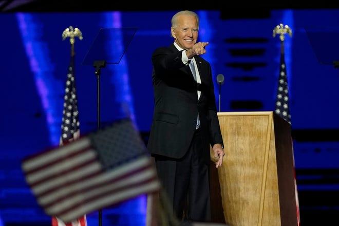 President-elect Joe Biden gestures on stage after speaking  Saturday in Wilmington, Delaware