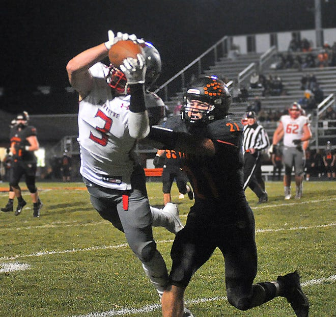 Norwayne's Hayden Tanner can't quite come down with this catch against Springfield's Beau Brungard. Tanner had 94 yards receiving and 31 yards rushing and two total TDs in Norwayne's 52-48 loss.