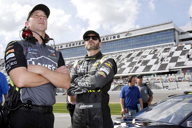 Crew chief Chad Knaus and Jimmie Johnson (from left) watch the leaderboard Feb. 11, 2018, during qualifying for the Daytona 500 at Daytona International Speedway. Johnson is retiring from full-time NASCAR competition in Sunday's season finale at Phoenix Raceway, leaving the sport as a seven-time champion ranked sixth on the all-time wins list with 83 career victories.