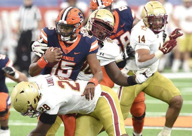 Syracuse quarterback JaCobian Morgan (15) is caught in the pocket by Boston College linebacker John Lamot (28) during the first half of Saturday's game in the Carrier Dome.