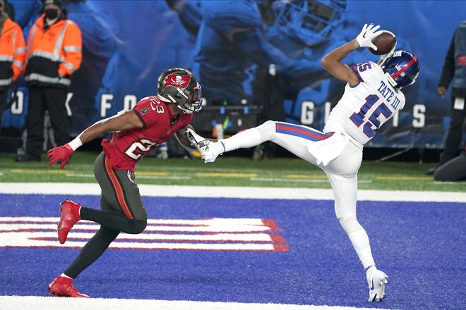 Golden Tate (right) catches a touchdown for the New York Giants in front of the Tampa Bay Buccaneers' Sean Murphy-Bunting during the second half of Monday's game in East Rutherford, New Jersey.