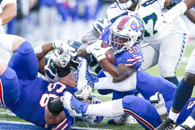 Buffalo Bill Zack Moss (20) rushes for a touchdown during the second half of Sunday's game against the Seattle Seahawks in Orchard Park, New York.