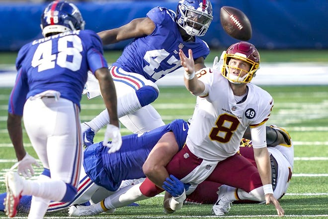 Washington Football Team quarterback Kyle Allen (8) loses control of the ball during the second half of an Oct. 18 game in East Rutherford, New Jersey. New York Giants linebacker Tae Crowder (48) recovered the ball and scored a touchdown on the play. A few weeks after a missed opportunity of a 20-19 loss at New York, Washington (2-5) can still move within a half-game of idle, first-place Philadelphia by evening the season series with the Giants.