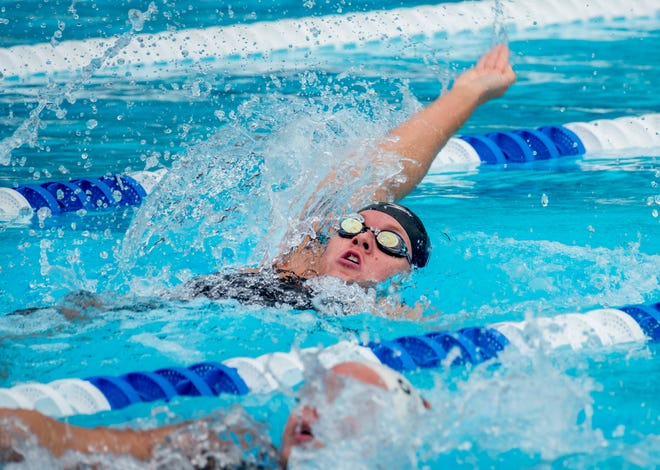Creekside's Jenny Bird participates in the 100-yard backstroke during the FHSAA swimming championships. Bird finished third in the event and helped the Knights to medley relay and overall state championships.