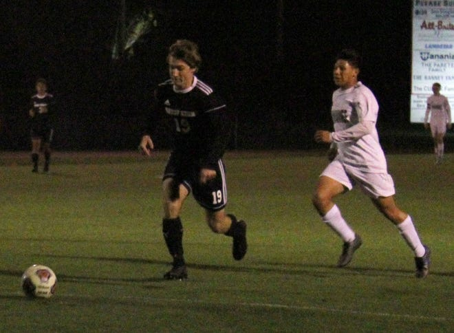 Bishop Kenny midfielder Sean Meisler (19) dribbles into the Suwannee defense during an FHSAA playoff game in February.