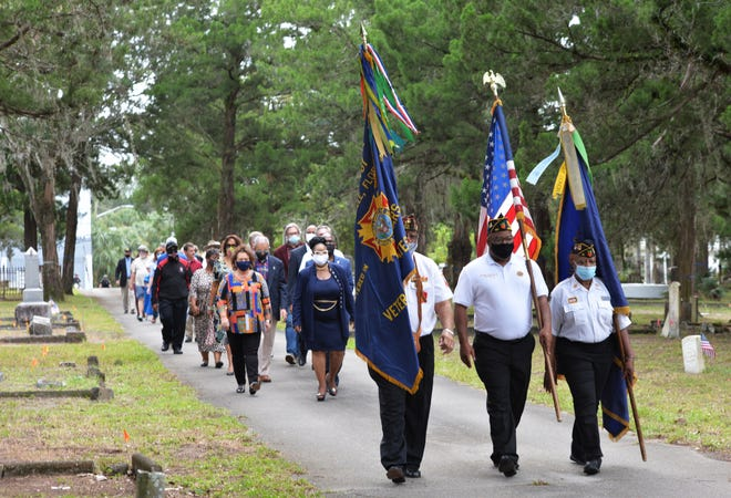 The Color Guard of American Legion Post 197 leads attendees to the annual Pre-Veterans Day Flag & Wreath Memorial Service of Remembrance at the Old City Cemetery on Sunday. The event honored the city's veterans — past and present — and marked the 144th birthday of the late Eartha M. M. White, founder of the Clara White Mission downtown.
