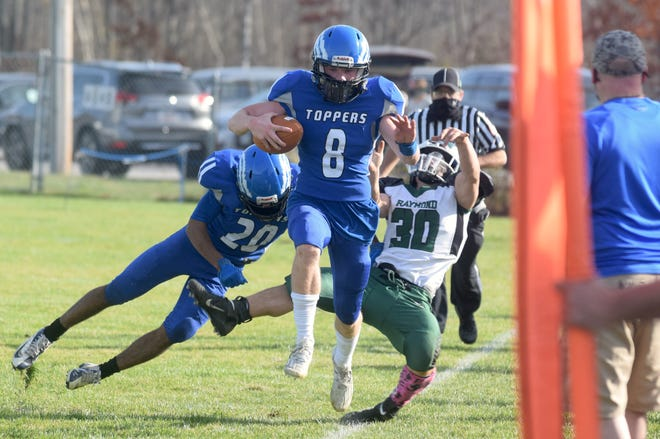 Somersworth High School's Logan Bryant (8) runs along the sideline as teammate Trent Evans (20) knocks Raymond's Joe Shanahan out of the play during the first half of Saturday's Division IV semifinal game in Somersworth.