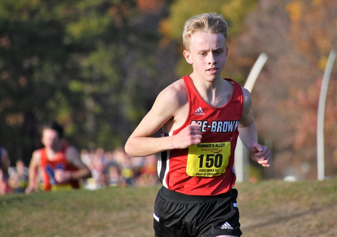 Coe-Brown's Aidan Cox set a new record for the NHIAA Meet of Champions at Nashua South High School in 14 minutes, 58.8 seconds.
