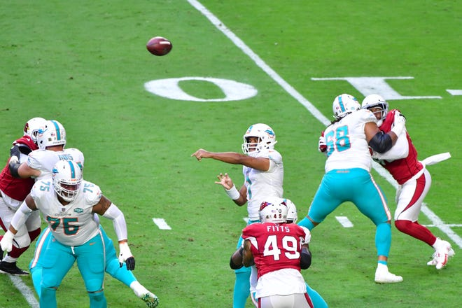 Dolphins quarterback Tua Tagovailoa passed with more confidence during Sunday's victory against the Cardinals.
