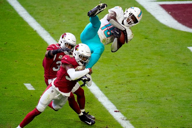 Dolphins receiver Preston Williams makes a 9-yard TD catch as Cardinals safety Jalen Thompson tries to defend.