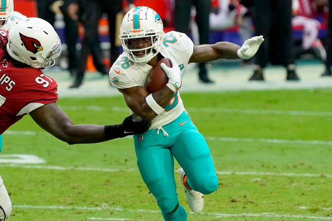 Salvon Ahmed was the Dolphins' leading rusher with 38 yards against the Cardinals.