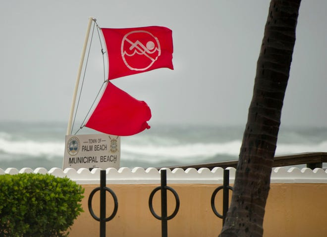 The is a no swimming advisory at Midtown Beach in Palm Beach due to Tropical Storm Eta Sunday November 8, 2020.