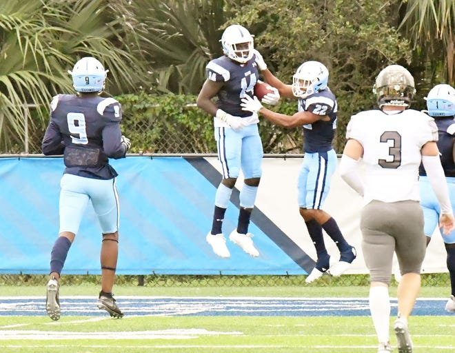 Keiser's Jaylen Arnold leaps into the air in celebration following a touchdown catch-and-run in the second quarter of Saturday's game against Ave Maria.
