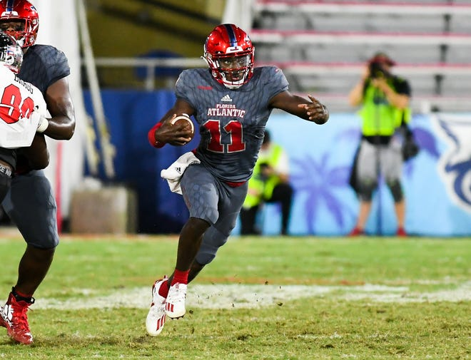Florida Atlantic Owls quarterback Javion Posey (11) rushes during a 10-6 win over the Western Kentucky Hilltoppers in Boca Raton on Saturday night.
