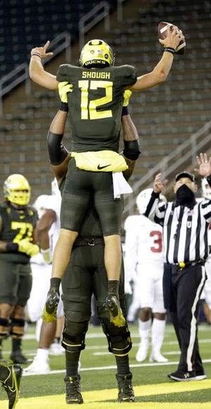 Oregon quarterback Tyler Shough (12) celebrates his touchdown in the third quarter of the Ducks' 35-14 win against Stanford on Saturday at Autzen Stadium. (Andy Nelson/The Register-Guard)