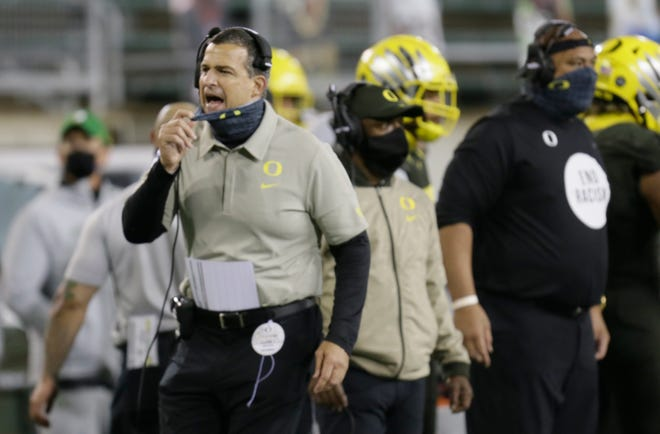 Oregon coach Mario Cristobal is preparing his team for Friday's Pac-12 championship game while also trying to dispel rumors about his interest in the job opening at Auburn.