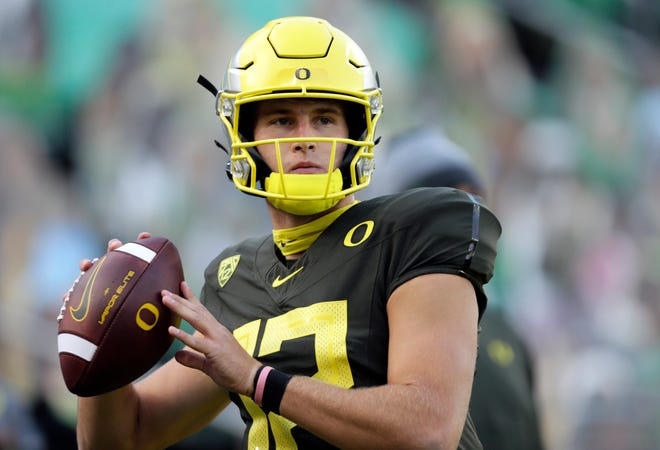 Oregon Ducks quarterback Tyler Shough (12) warms up for a Nov. 7 game against Stanford. Shough, who started all seven games Oregon played last year, has arrived at Texas Tech as a graduate transfer and will join the Red Raiders when spring practice resumes Tuesday.