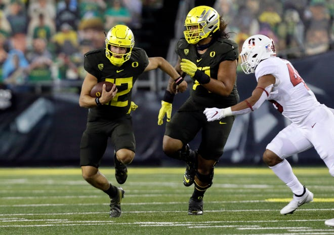 Oregon quarterback Tyler Shough ran for 85 yards and a touchdown and threw for 227 yards and a touchdown in the Ducks' 35-14 win.