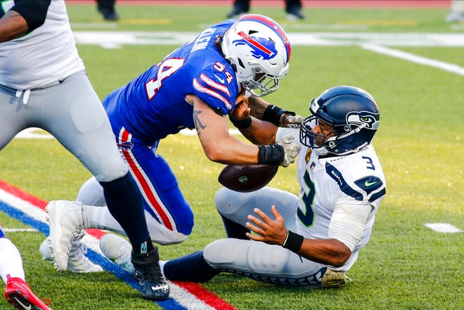 Buffalo Bills' A.J. Klein (54) strip sacks Seattle Seahawks quarterback Russell Wilson (3) during the second half of an NFL football game Sunday, Nov. 8, 2020, in Orchard Park, N.Y. (AP Photo/Jeffrey T. Barnes)