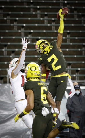 Oregon cornerback Mykael Wright (2) breaks up a pass intended for Stanford wide receiver Simi Fehoko (13) during the second quarter of the Duck' 35-14 win on Saturday at Autzen Stadium. (Andy Nelson/The Register-Guard)
