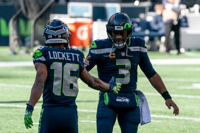 Wide receiver Tyler Lockett (16) and quarterback Russell Wilson lead the Seattle Seahawks against the Buffalo Bills on Sunday.