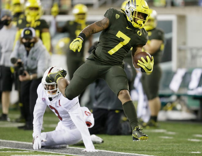Oregon's CJ Verdell (7) ran for 105 yards in Saturday's season-opening win over Stanford at Autzen Stadium.