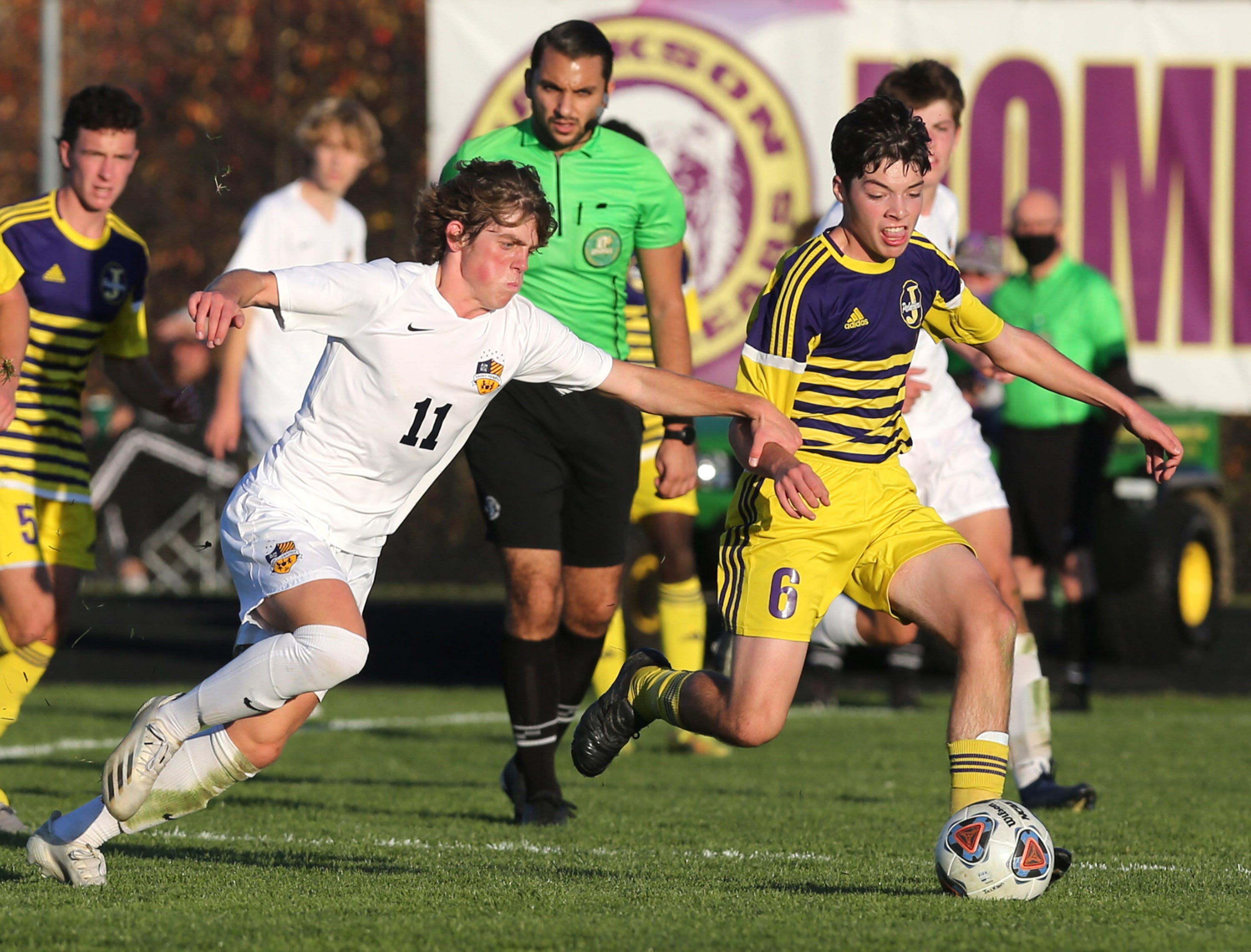 Ethan Corsi (6) of Jackson is slowed down by Luciano Pechota (11) of Saint Ignatius during their DI regional final at Jackson on Saturday, Nov. 7, 2020.