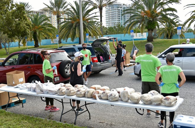 All Faiths Food Bank distributed about 700 free turkeys, and sides, to needy individuals and families Nov. 7, in Sarasota.