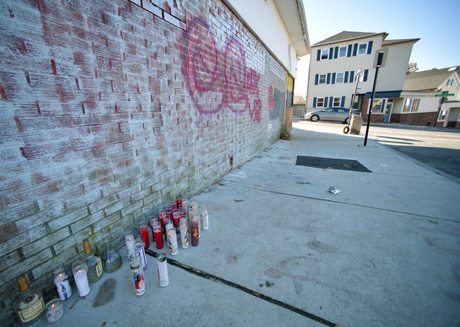 WORCESTER -  Outside of a market at Harrison and Providence streets Sunday, candles and liquor bottles are set up in a memorial to Kevin Mulready, a basketball standout who friends say died this weekend.