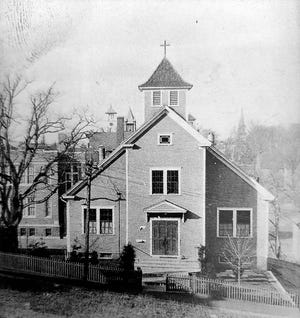 One of the few existing pictures of the first St. Mary's Church.