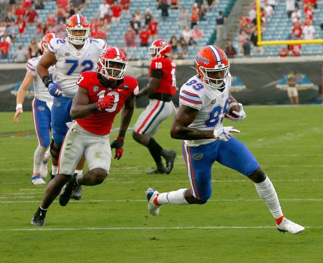 Florida receiver Justin Shorter runs for a touchdown after catching a pass from Kyle Trask during Saturday's game against Georgia at TIAA Bank Field in Jacksonville.