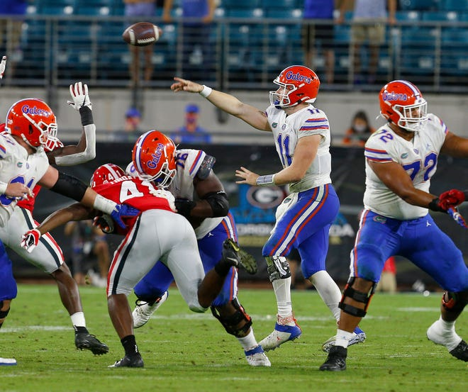 Florida quarterback Kyle Trask throws a pass behind the protection of his offensive line Saturday against Georgia at TIAA Bank Field in Jacksonville.