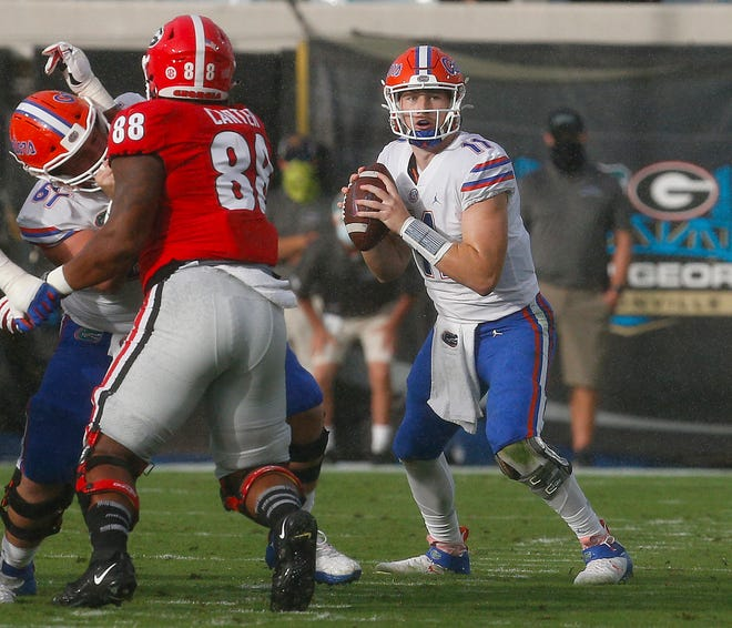 Florida quarterback Kyle Trask (11) throws a pass during the annual Florida-Georgia rivalry game held at TIAA Bank Field.